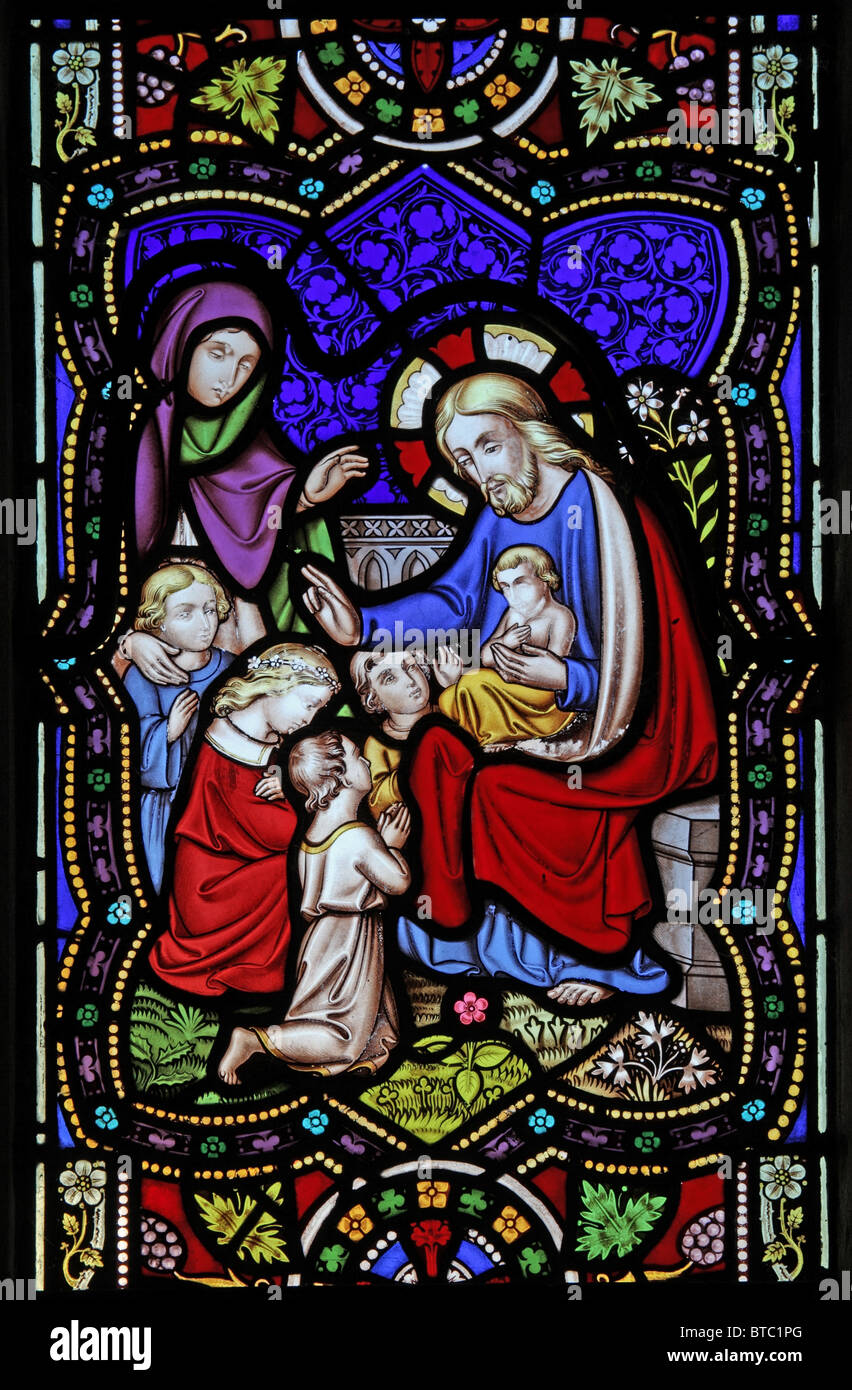 a stained glass window depicting jesus preaching to children