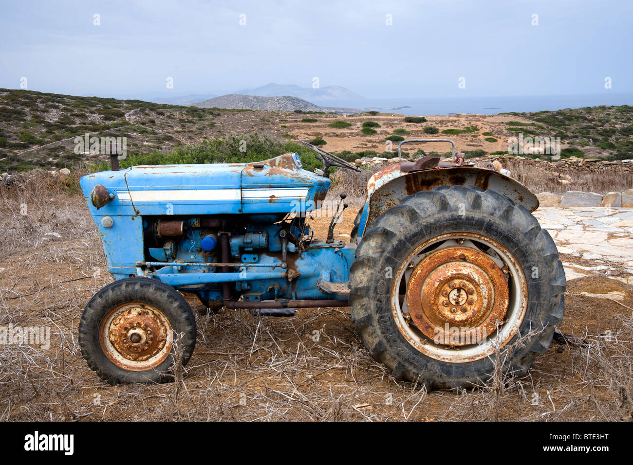 Old ford 2000 farm tractor in a field taken near arkesini on amorgos the