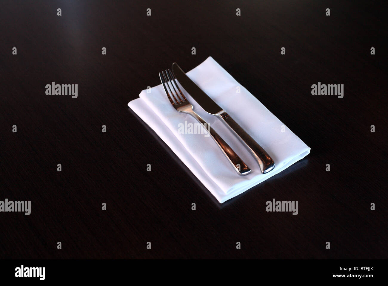 Modern restaurant table setting - Stock Photo Knife Fork Steel Eating Cutlery Utensils Modern Napkin White Restaurant Table Setting