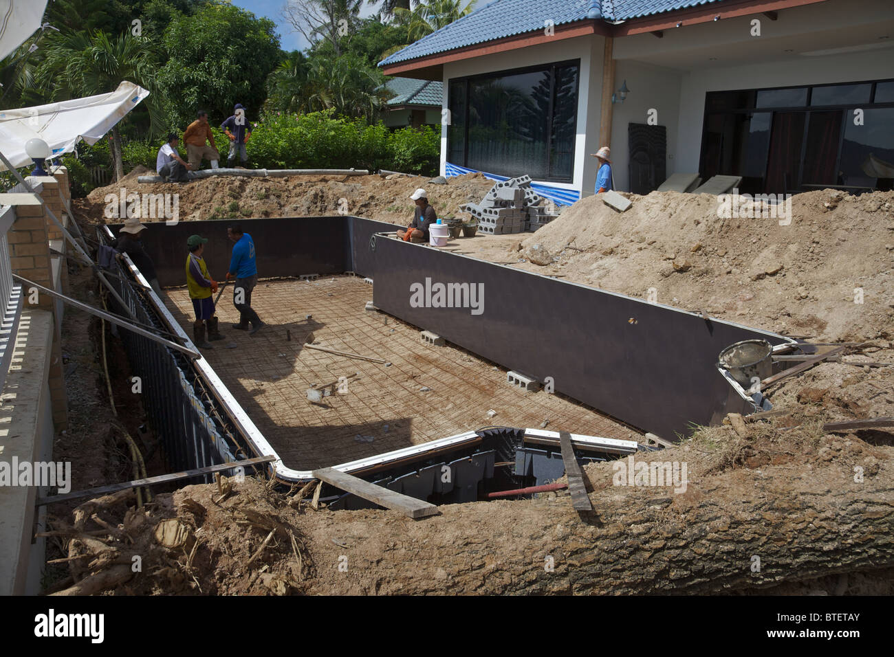 A swimming pool being built in phuket thailand stock for Built in swimming pool