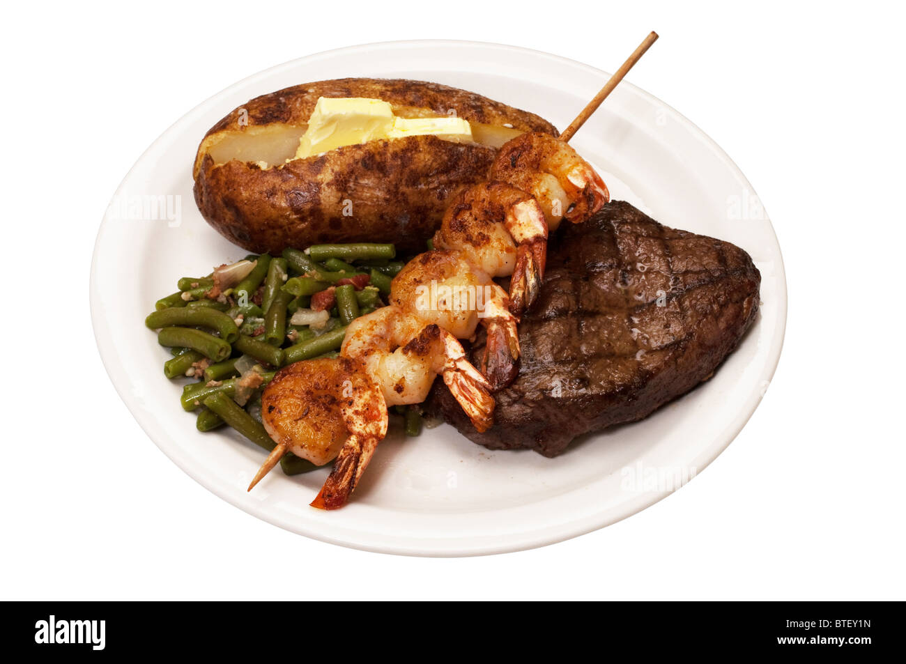 Turf N Surf >> Sirloin steak with baked potato, green beans and shrimp on skewer Stock Photo, Royalty Free ...