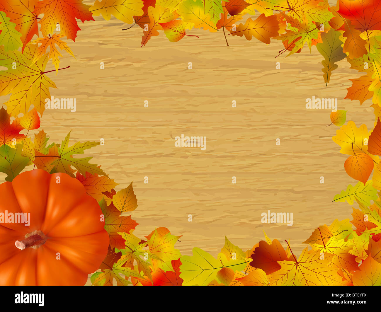 fall leaves and pumpkins on wood background stock photo