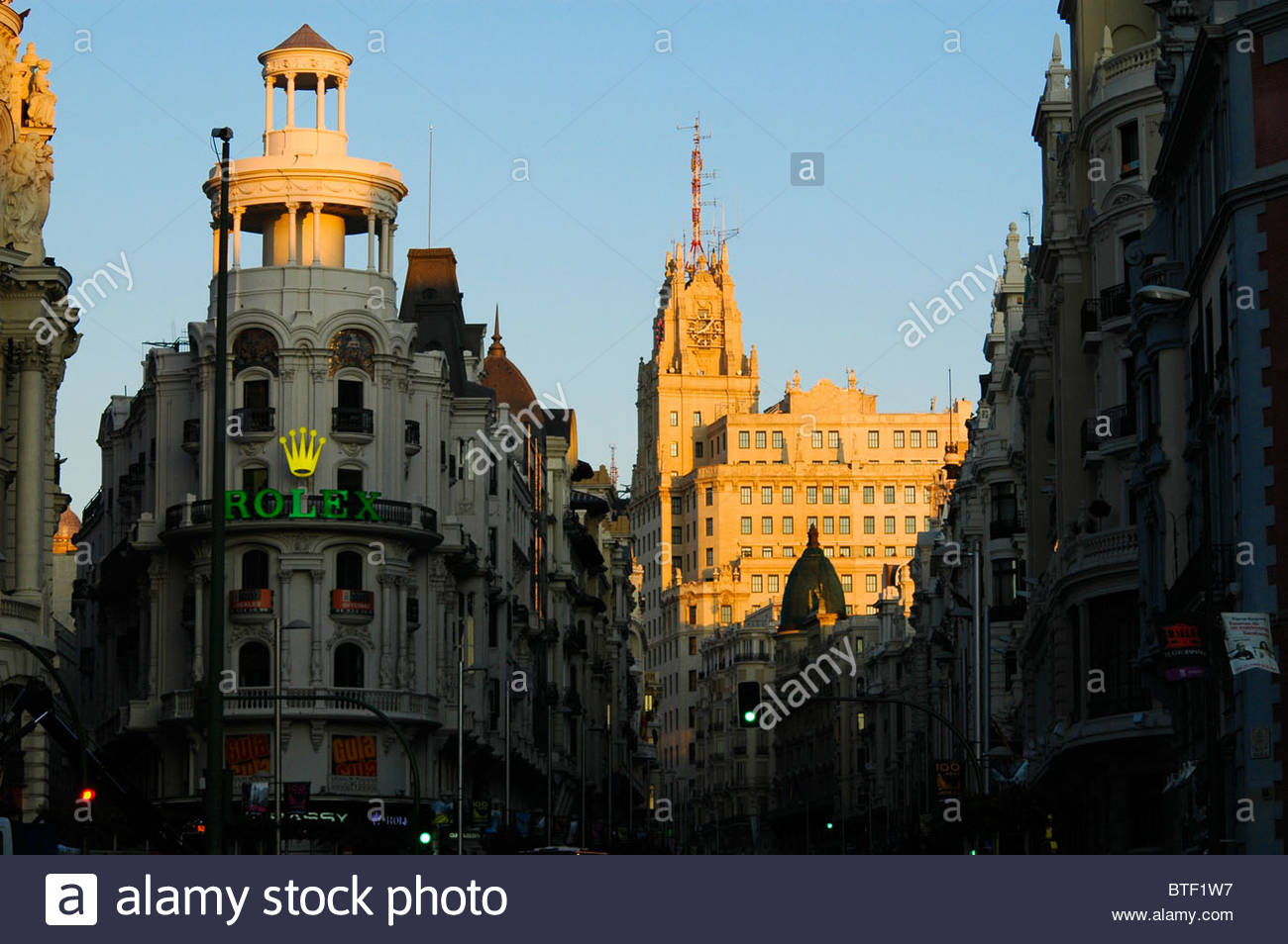 stock photo the start of the gran via in madrid at the junction with calle de alcala in the background is the edificio telefonica building