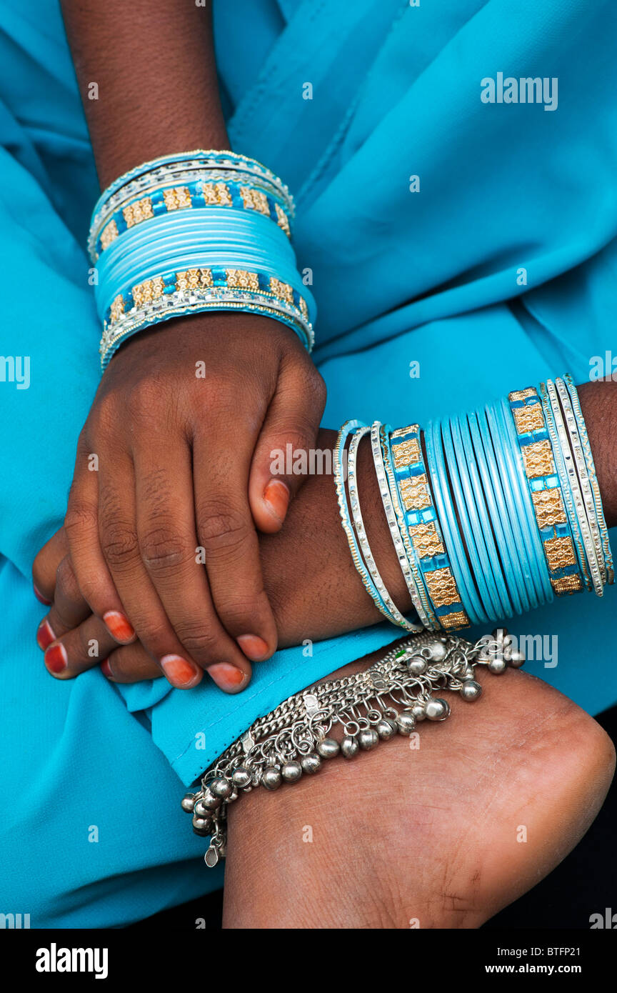 Young Indian girls hands and feet with bangles and ankle bracelets ...