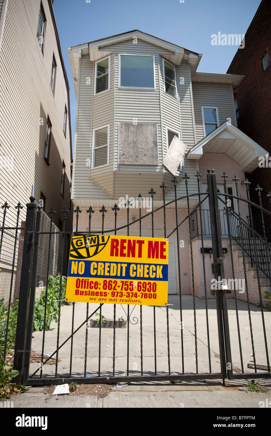 A No Credit Check Rent Me Sign On A House Gate In Newark NJ USA