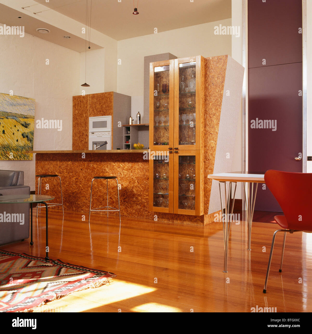 Kitchen Floor Units Lacquered Wood Chip Surface On Fitted Units In Modern Kitchen With
