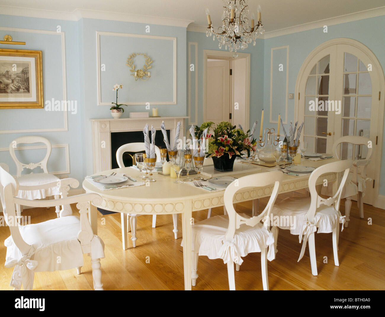 Painted cream table and chairs with white cushions in for Cream dining room table and chairs