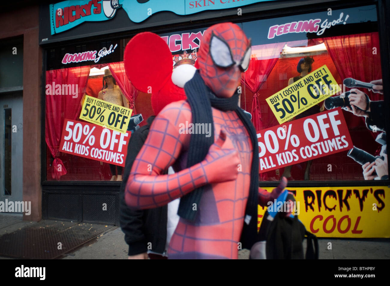 A Ricky's store in New York advertises costumes on sale on ...