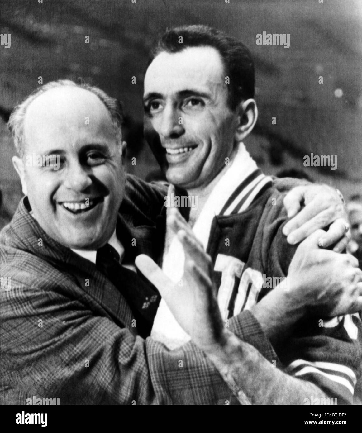 Boston Celtics coach Red Auerbach hugs Bob Cousy after their 1963