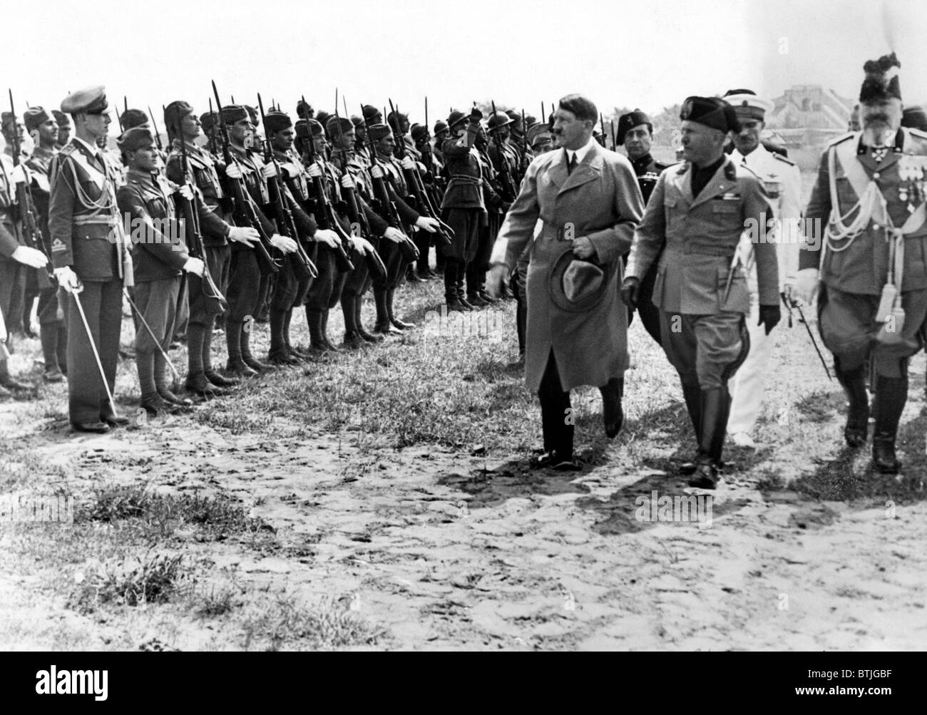 Adolf Hitler and Benito Mussolini as they inspect Italian ...