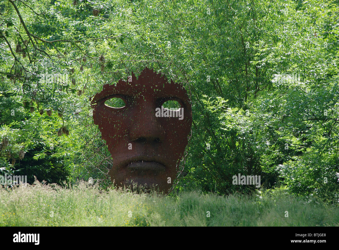 Metallic Sculpture Of A Face In The Sculpture Garden At Burghley House,  Stamford, Lincolnshire, UK