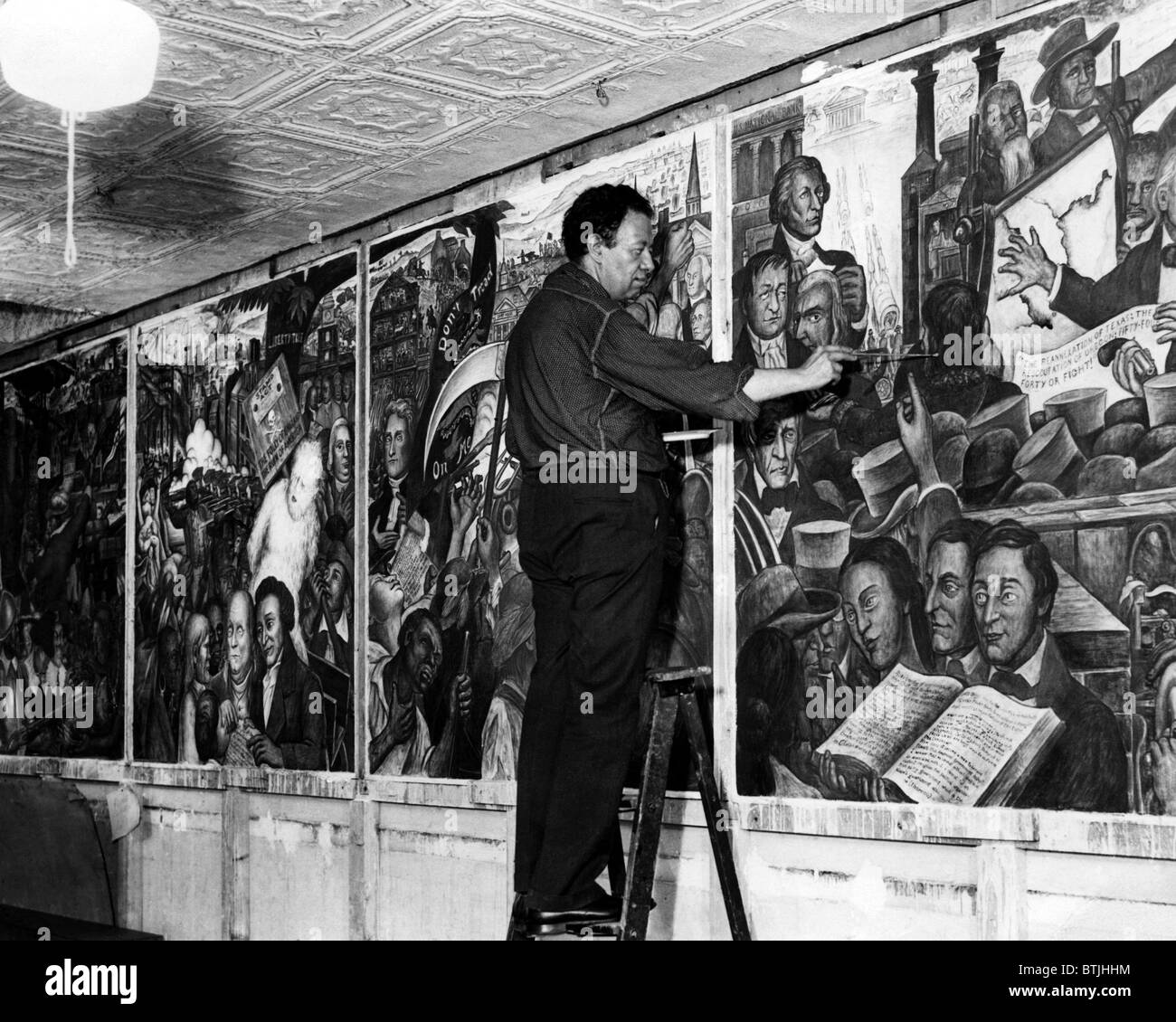 Mexican painter diego rivera painting a mural at the new for Diego rivera mural new york