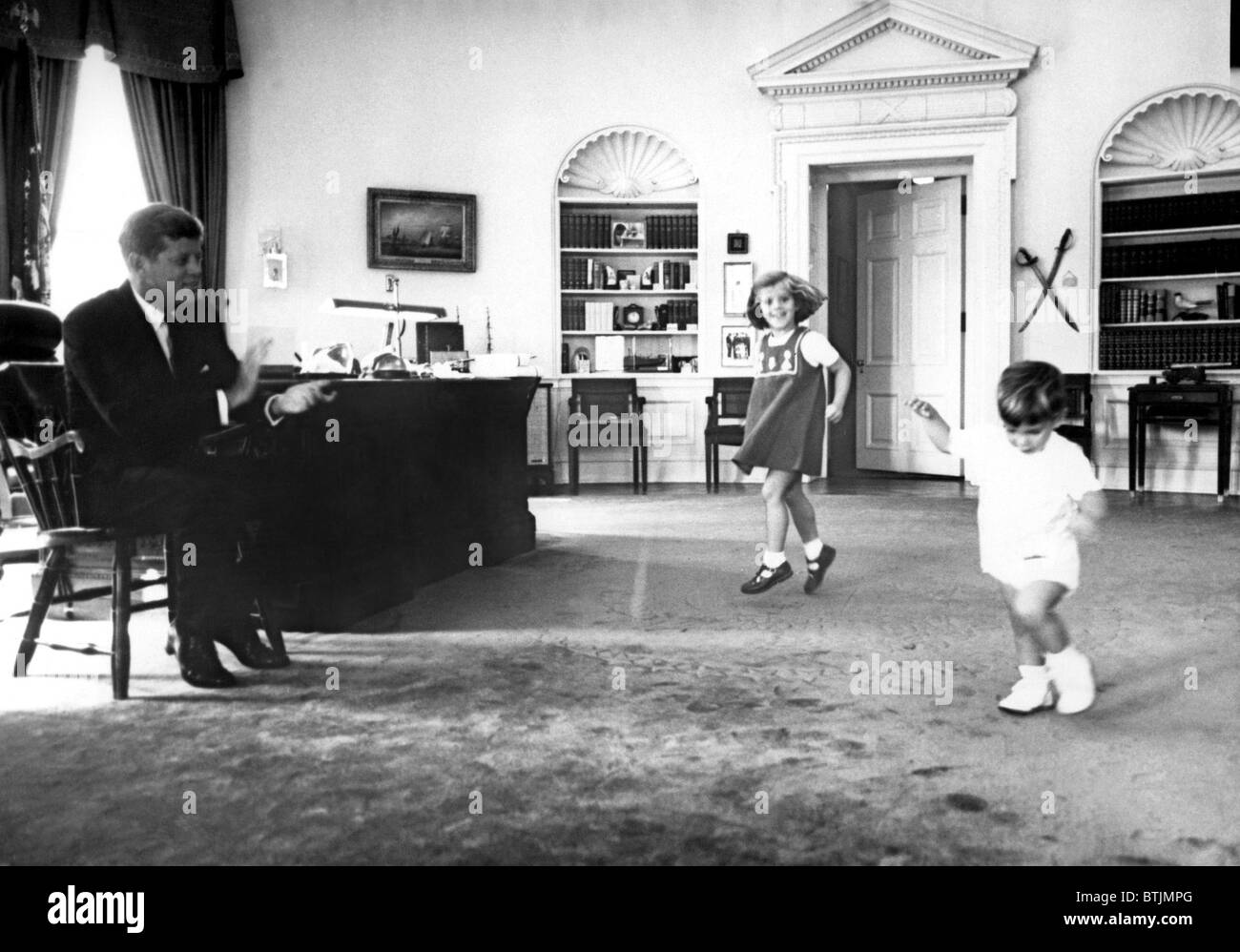 john f kennedy in oval office with children caroline