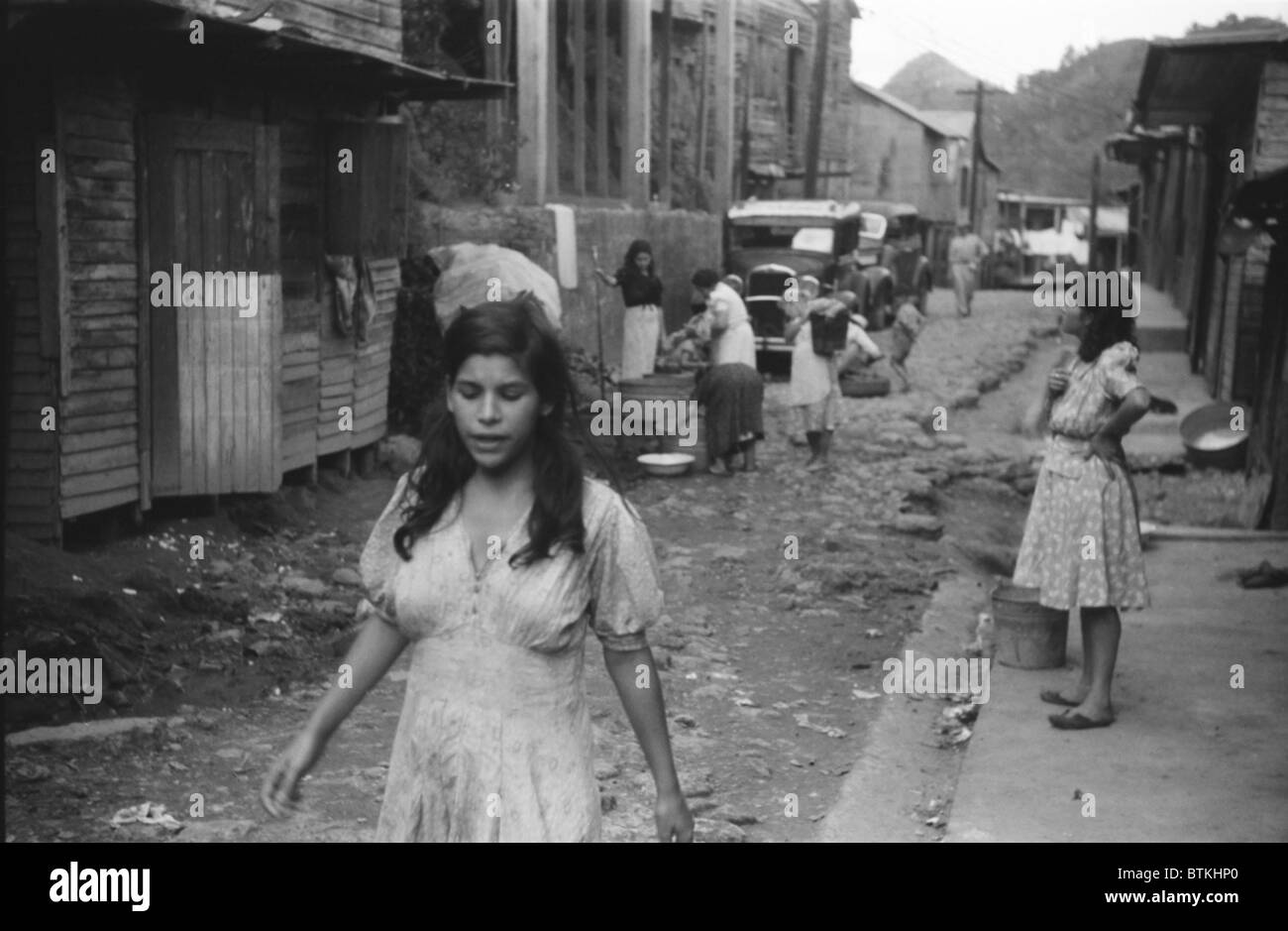 A street in the slum area of the hill town of lares in western a street in the slum area of the hill town of lares in western puerto rico january 1942 photograph by jack delano publicscrutiny Image collections