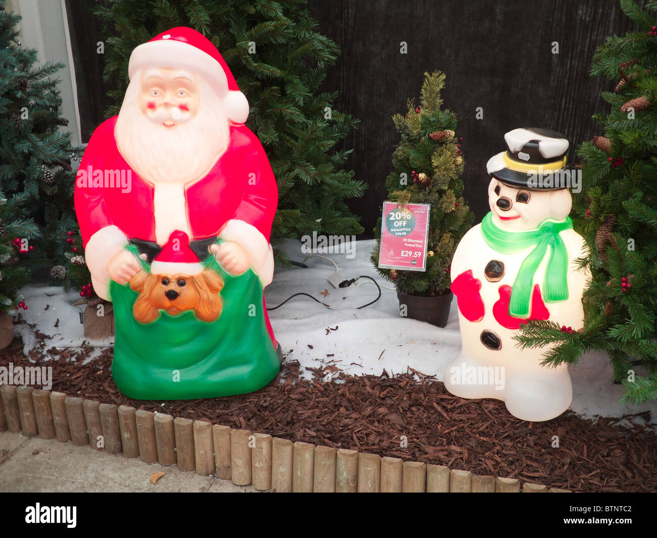 Garden decorations for sale - Illuminated Plastic Father Christmas And Snowman Decorations For Sale In A Garden Centre