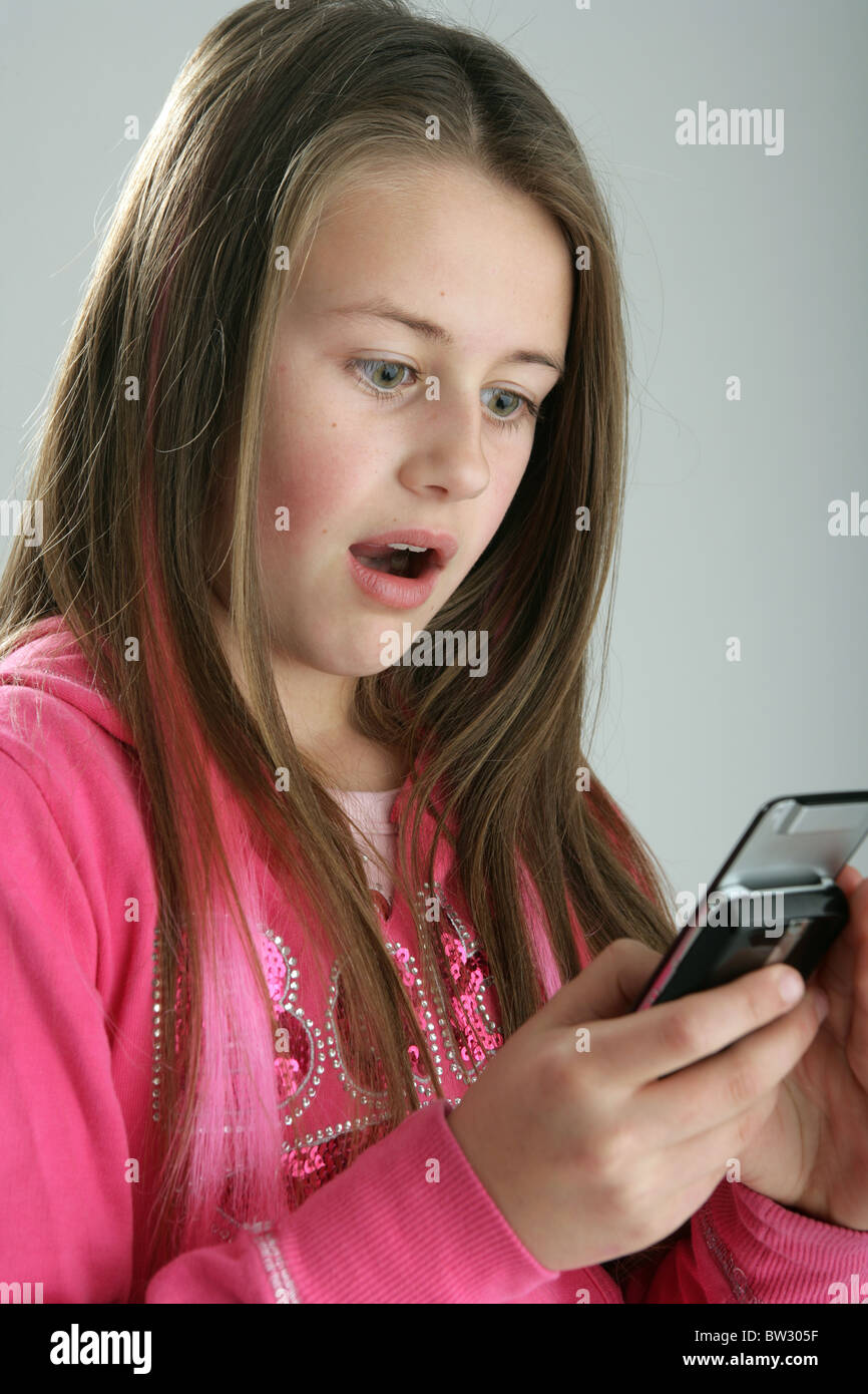10 Year Old Girl And Texting Stock Photos & 10 Year Old Girl And ...