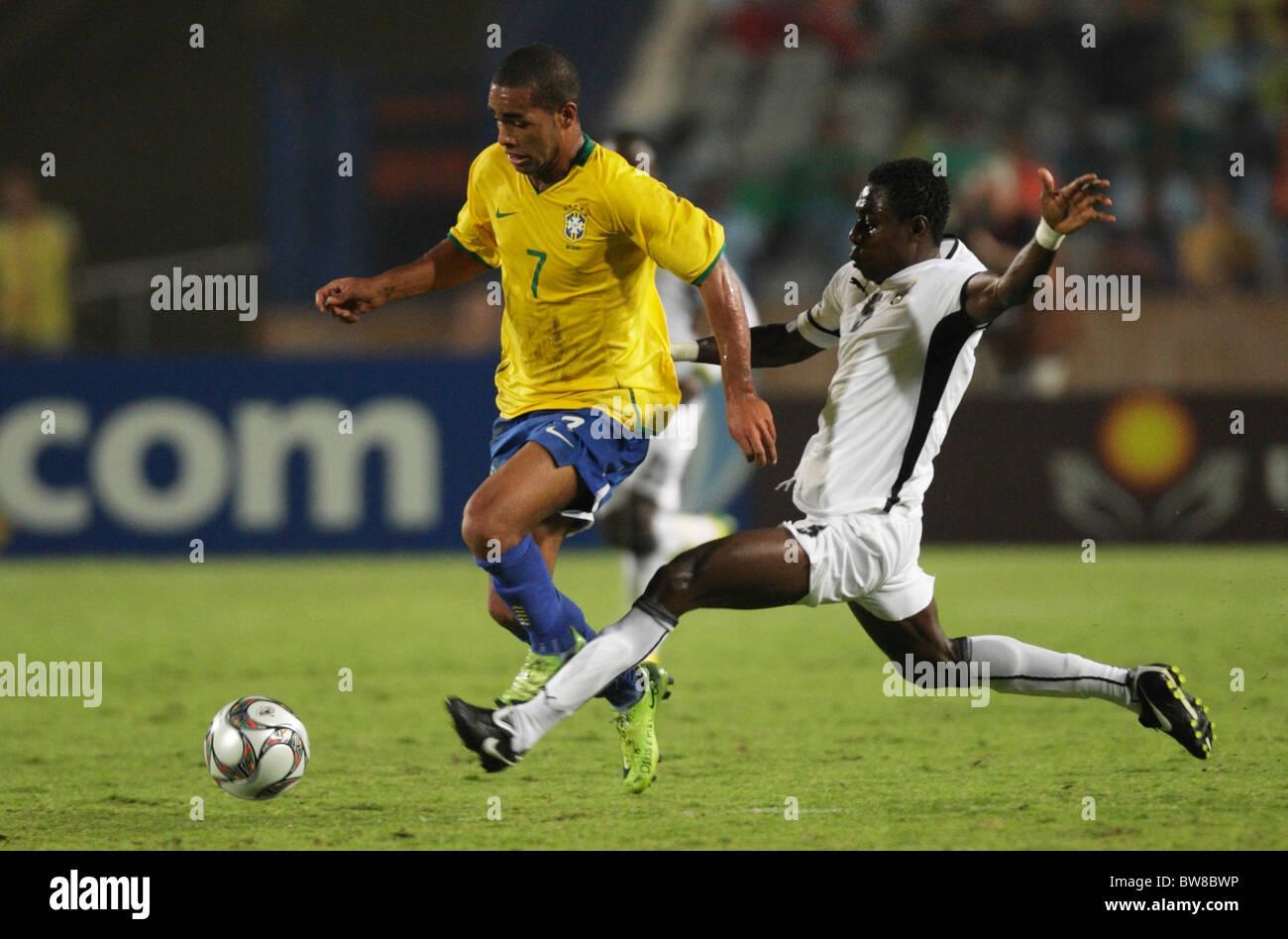 Daniel Addo of Ghana r tries to tackle Alex Teixeira of Brazil