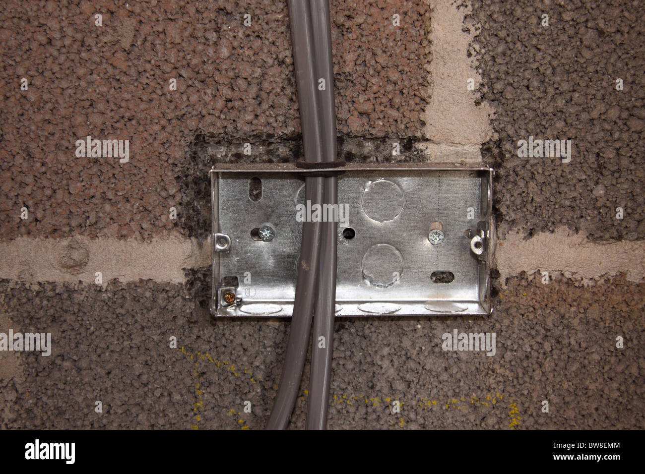 How To Install A Wall Light Junction Box : Electrical Light switch box during installation on a block work wall Stock Photo, Royalty Free ...