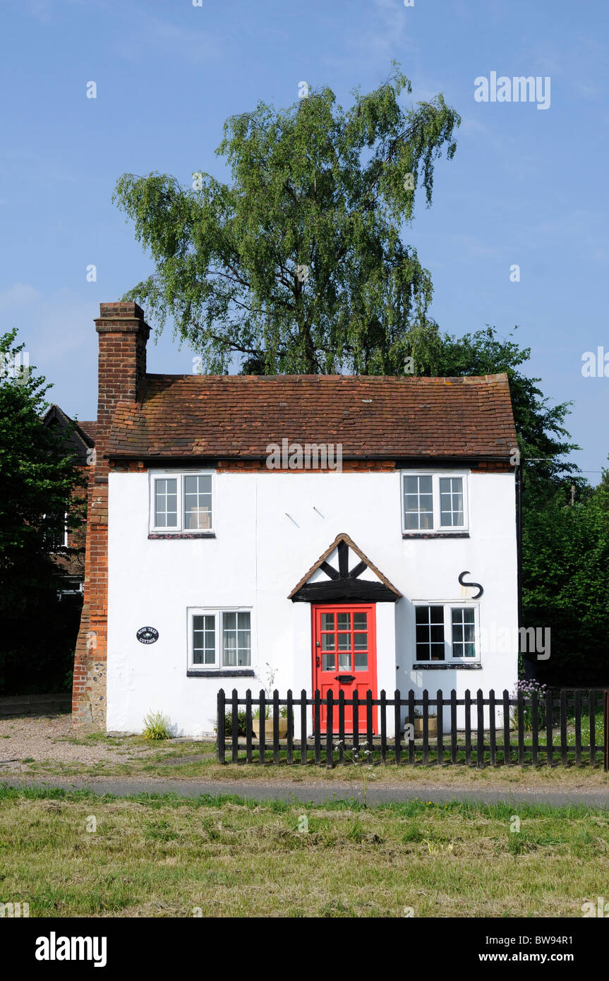 A white tiled english country cottage with red door and for Red cottage