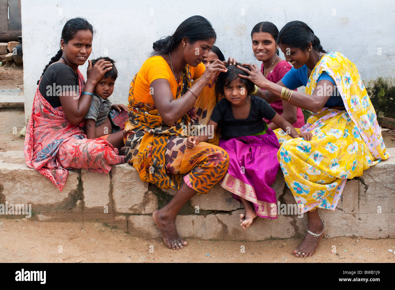 Indian Mothers Nitpicking Young Girls Head In A Rural Indian ...