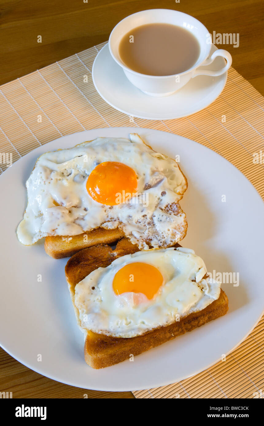 Table Setting For Breakfast Food Cooked Meals A Breakfast Table Setting Of Two Fried Eggs