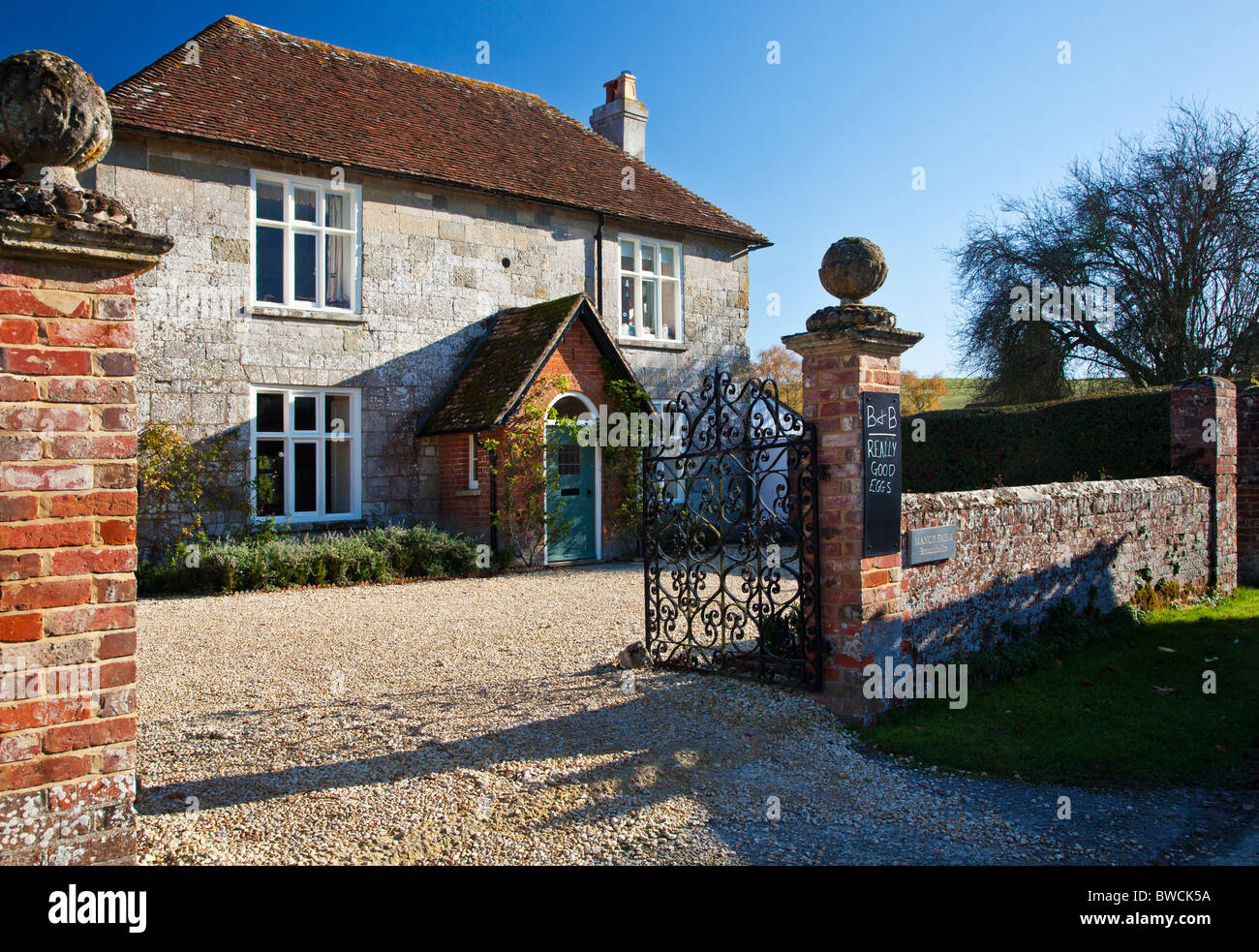 A Typical English Stone Country Farmhouse In Broad Chalke Wiltshire England UK