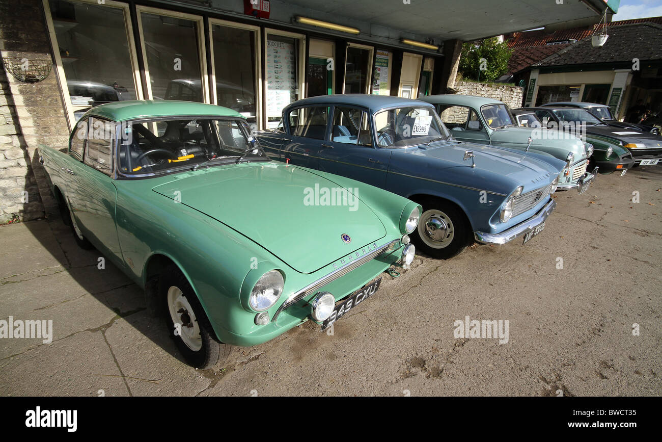Old cars for sale in row outside specialist dealer garage Stock ...