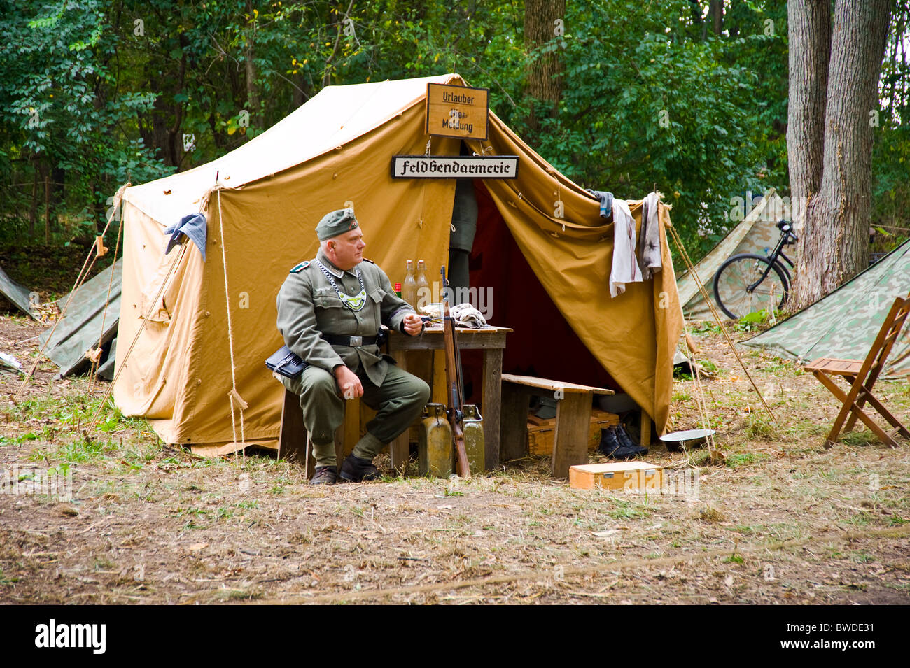 German army officer world war two time sitting near tent c& c&ing acting show wood forest bench table & German army officer world war two time sitting near tent camp ...