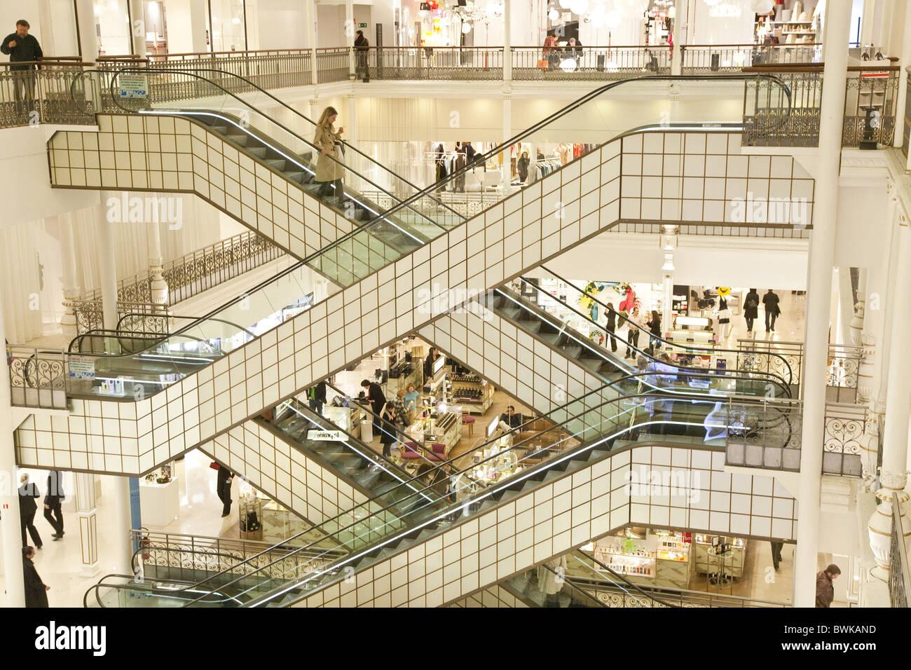 people on escalators. people on escalators at department store le bon marché, 7th arrondissement, paris, france, europe