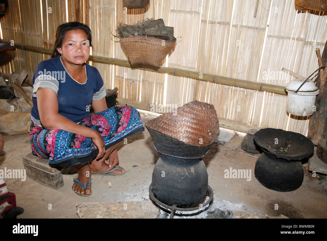 laos asia miao minority hmong people village hut woman cooking