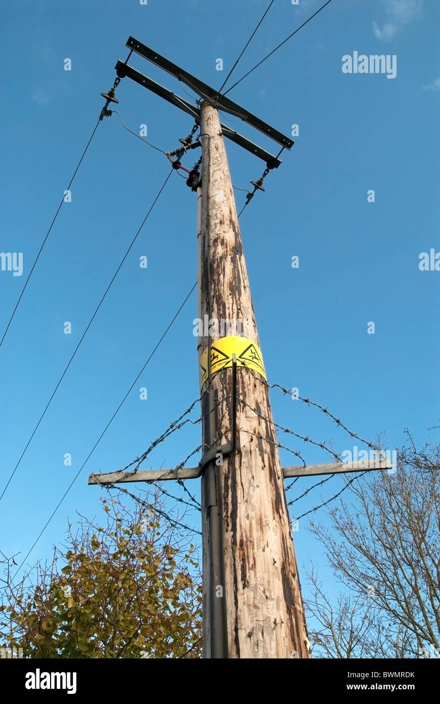 Wooden Post Electricity Pylons with Power Lines and Barbed Wire ...