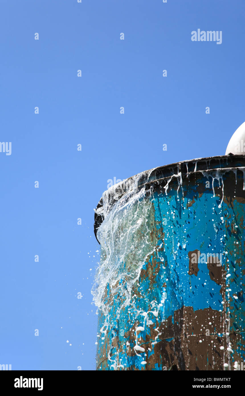 Water Overflowing From Industrial Tank Stock Photo
