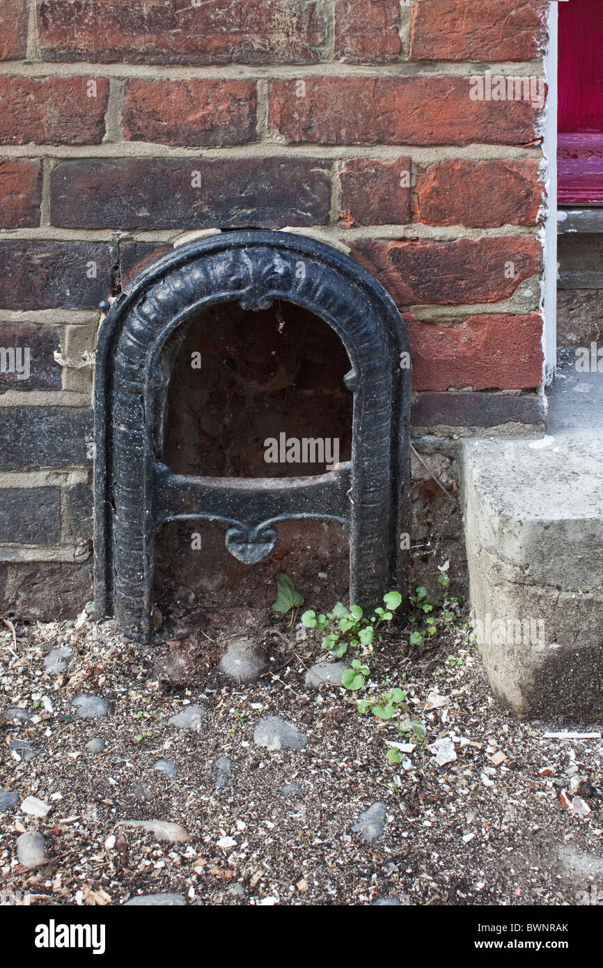 cast iron boot scraper set in wall of house in canterbury