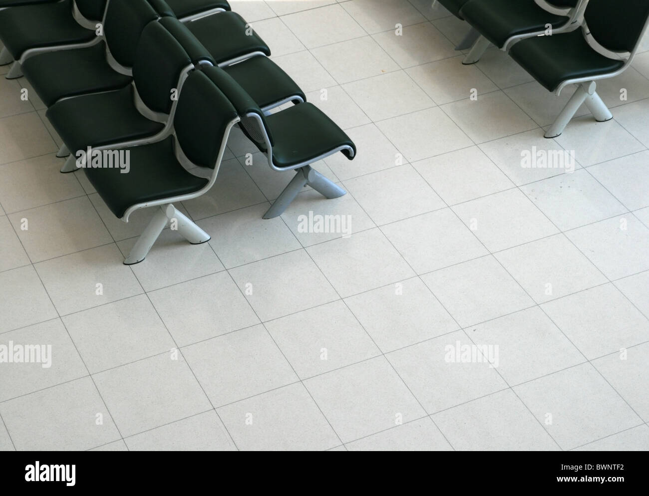 Waiting area with black padded seats and light tile floor from waiting area with black padded seats and light tile floor from above dailygadgetfo Images