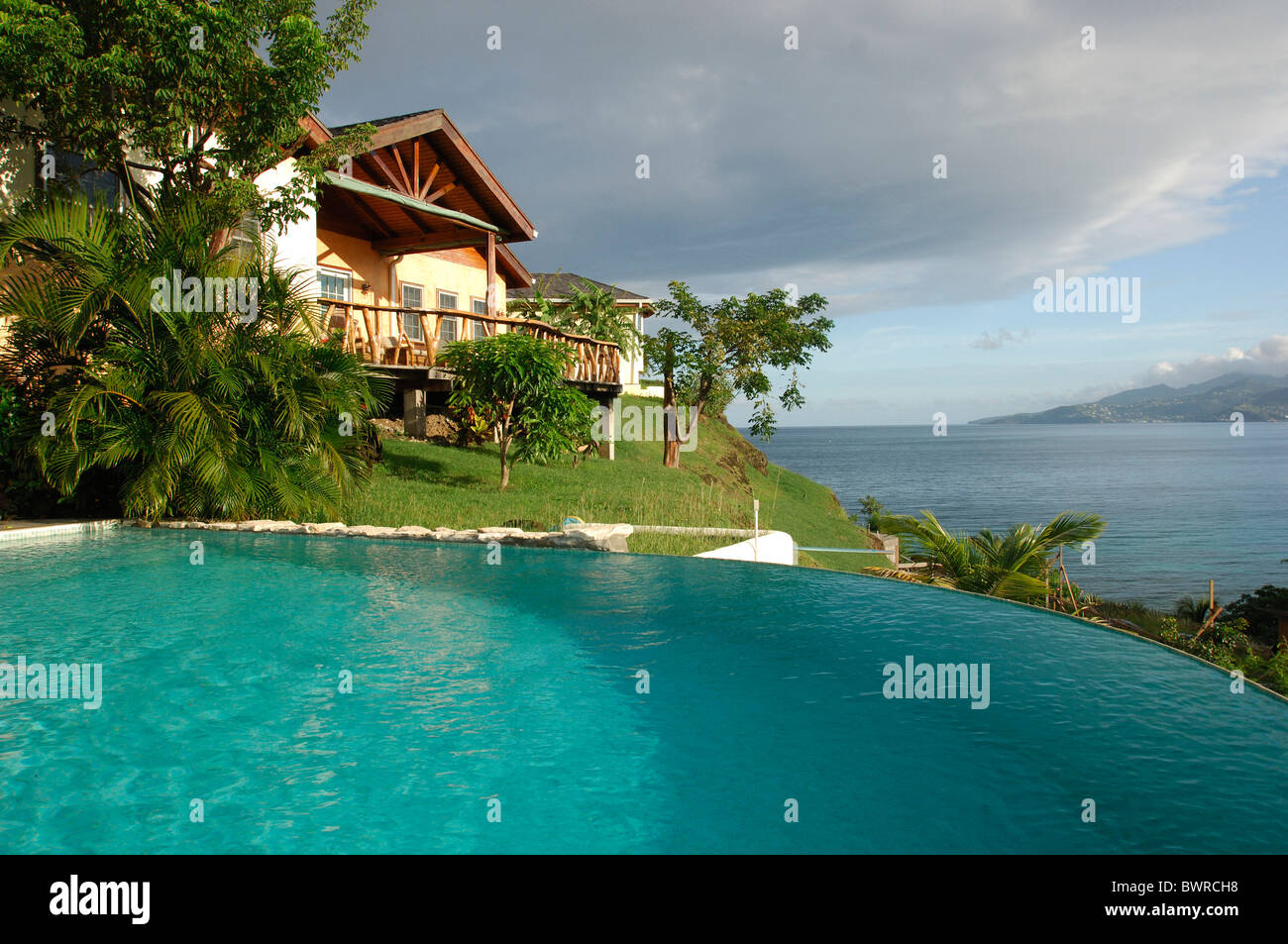 Grenada maca bana villas caribbean island swimming pool hotel resort building house palm trees tourism trave