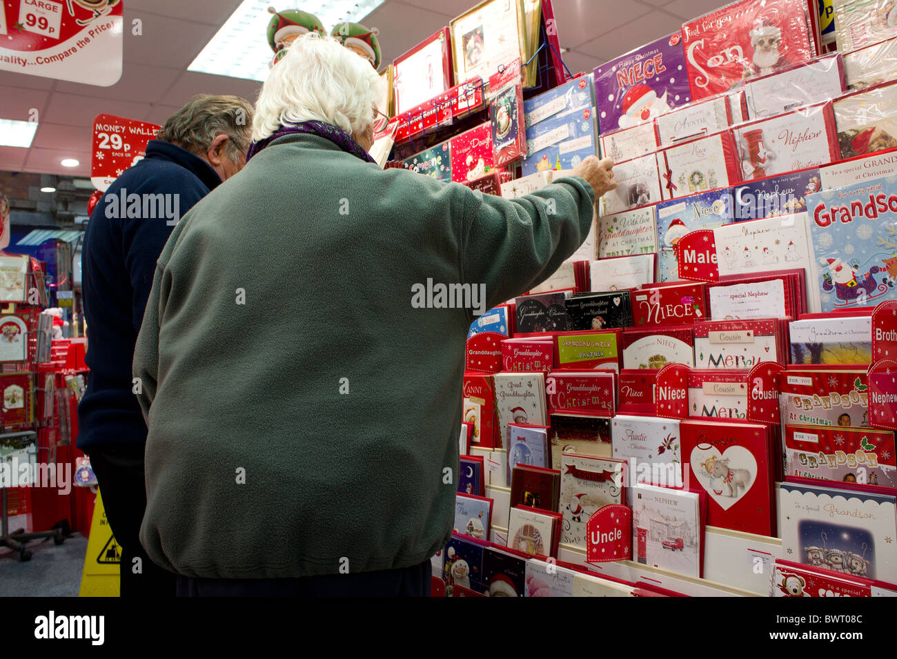 an elderly woman buying christmas cards Stock Photo, Royalty Free ...