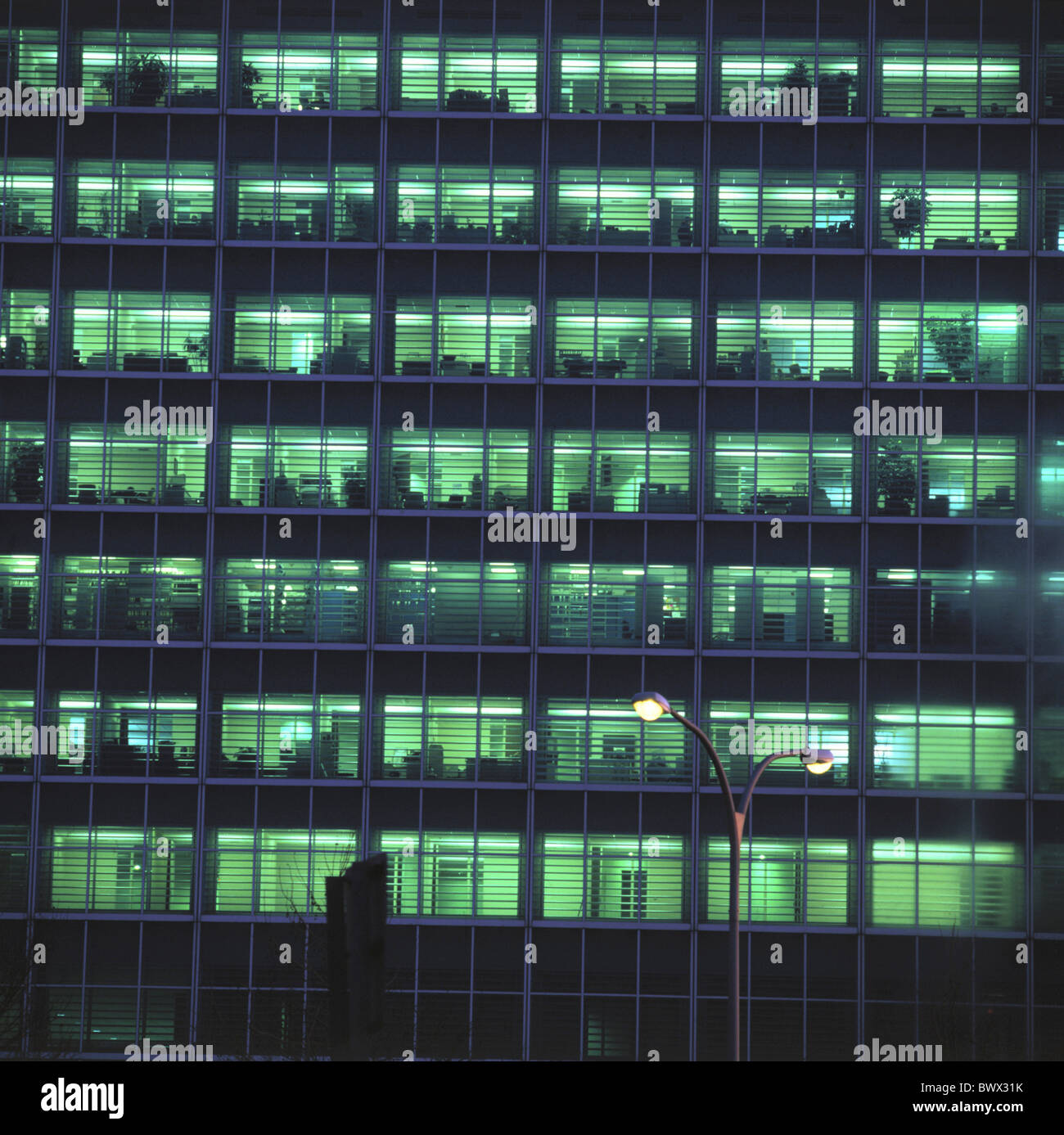 Window at night from outside - Stock Photo Building Construction Night Offices Outside Illuminated Office Facade Window At Night