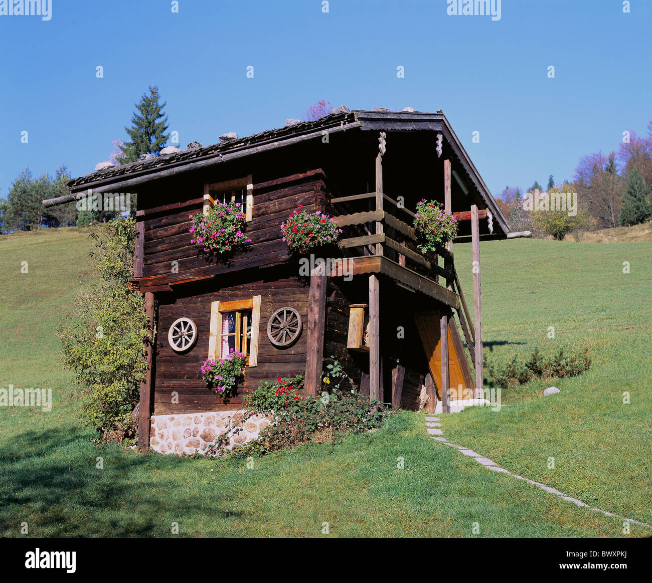 Timber house log cabin small balcony meadow germany europe for Small house design germany