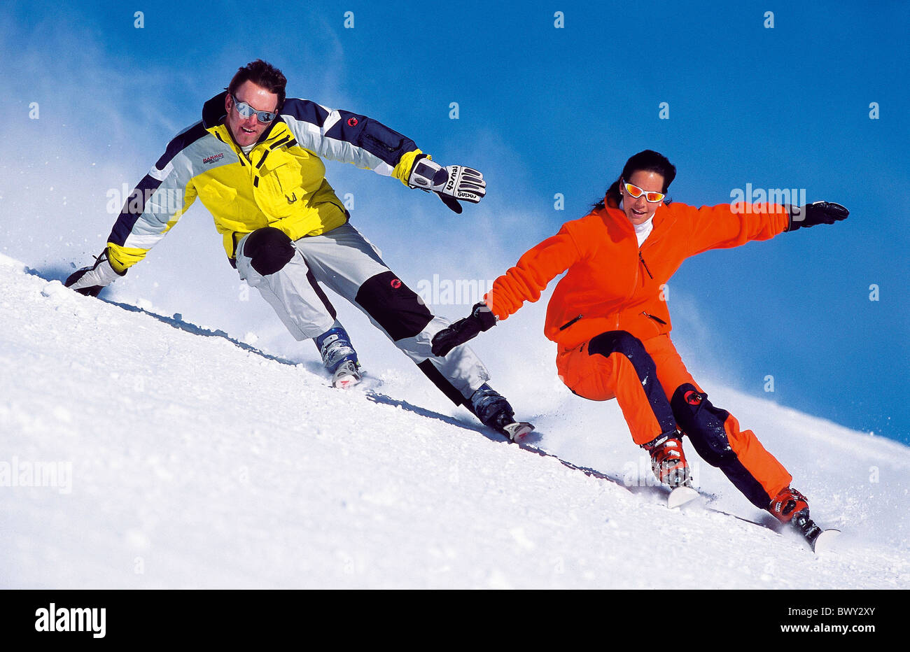 Action carving ski carvingski pair couple snow skiing