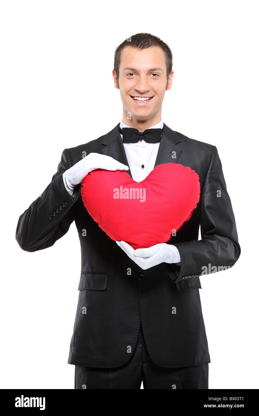 Man Shaped Pillow A Happy Man Holding A Red Heart Shaped Pillow Stock Photo Royalty
