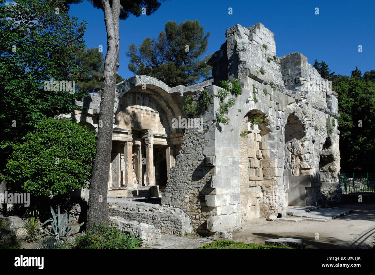 roman remains or ruins of the temple of diana jardin de la fontaine stock photo royalty free. Black Bedroom Furniture Sets. Home Design Ideas