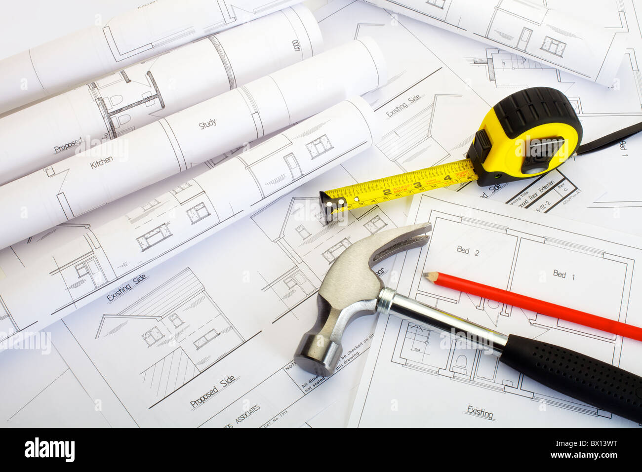 Close up of house extension or building plans with tape measure ...