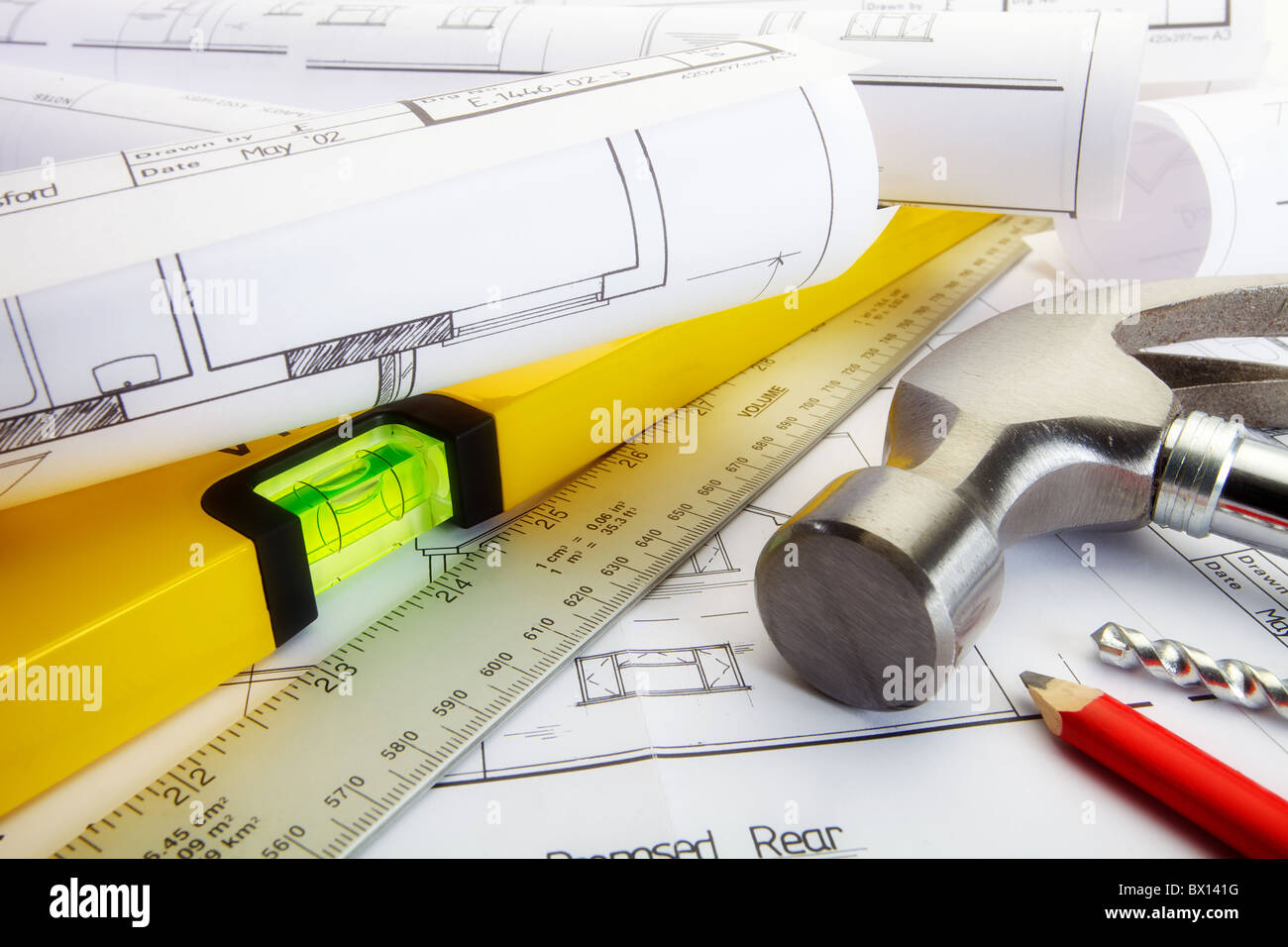a close up of house building plans and construction tools stock