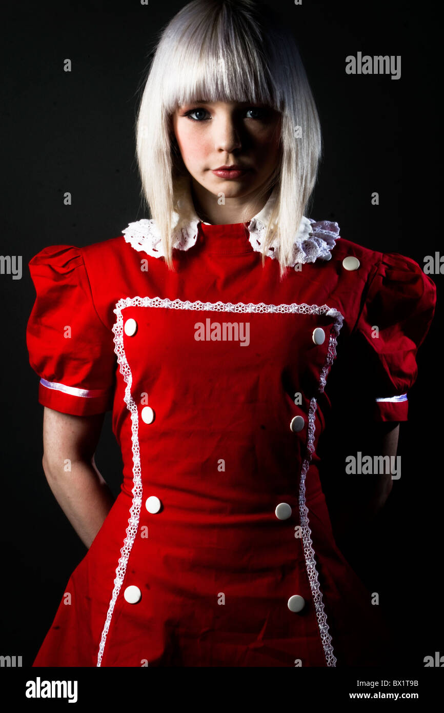 young lolitas  blogintriga Fashion portrait of a young blonde model wearing a red gothic lolita dress. - Stock