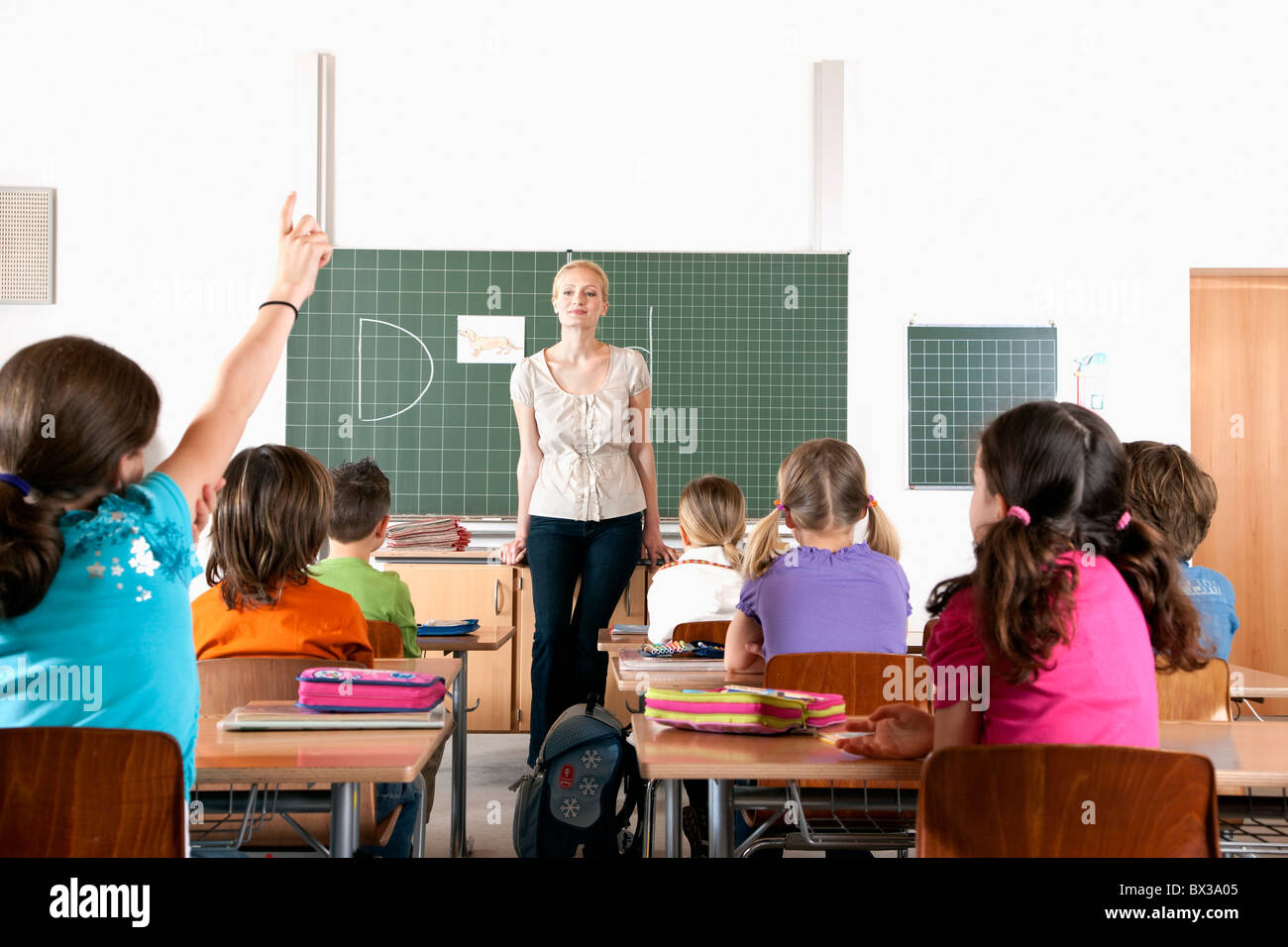 Female Teacher In Front Of Class Stock Photo Royalty Free