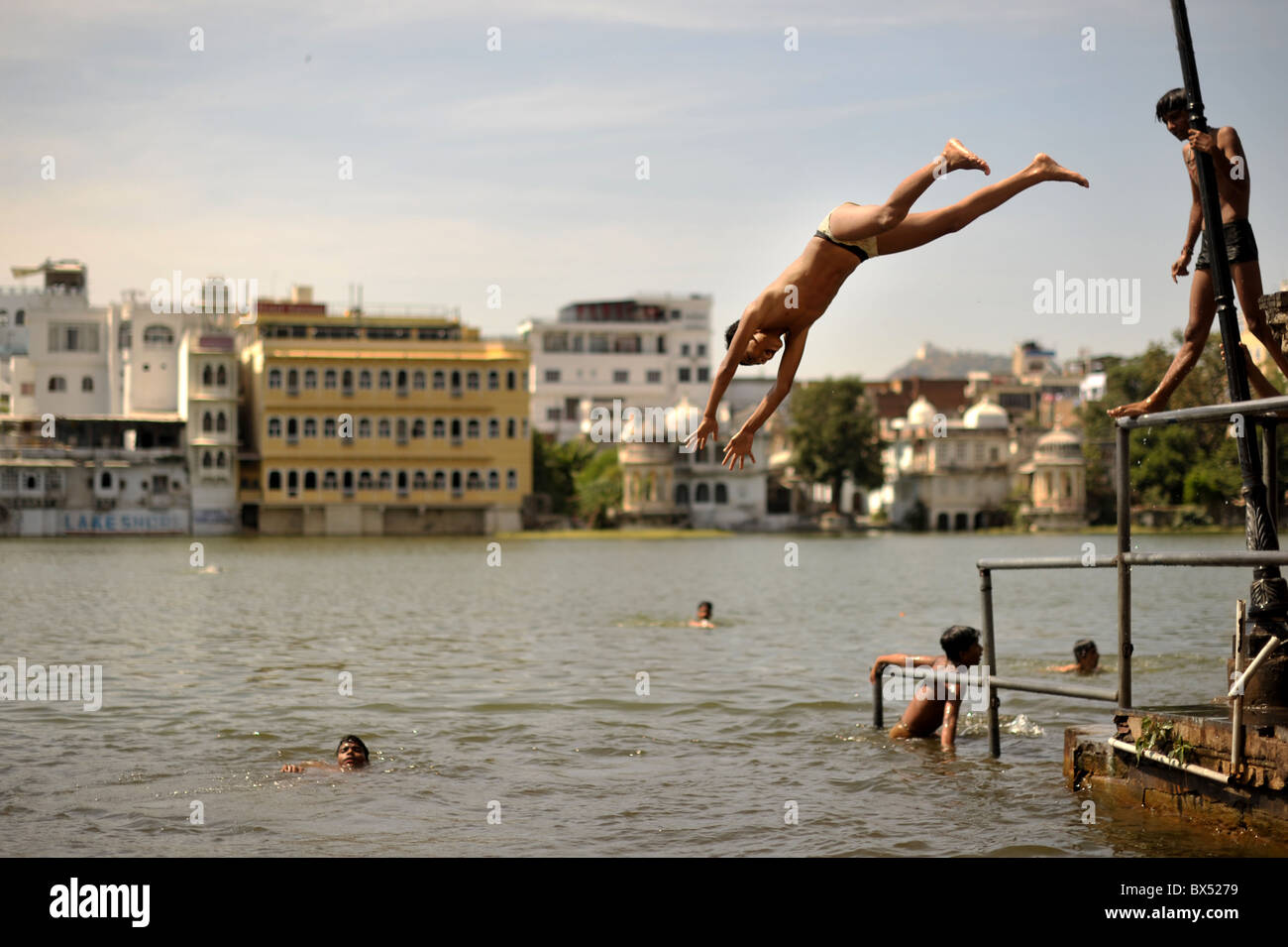 Children Jump And Swim In A Lake In Udaipur Rajasthan India Stock Photo Royalty Free Image