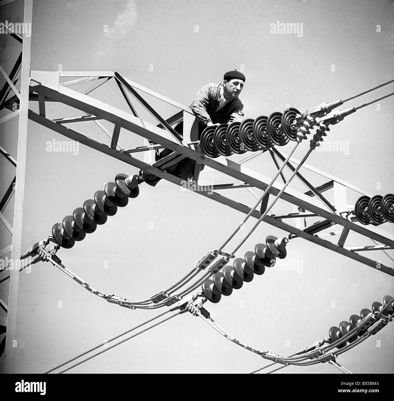 Electrician Works Overhead On High Voltage Wires Near Melnik,  Czechoslovakia 1960. (CTK Photo / Jiri Finda)
