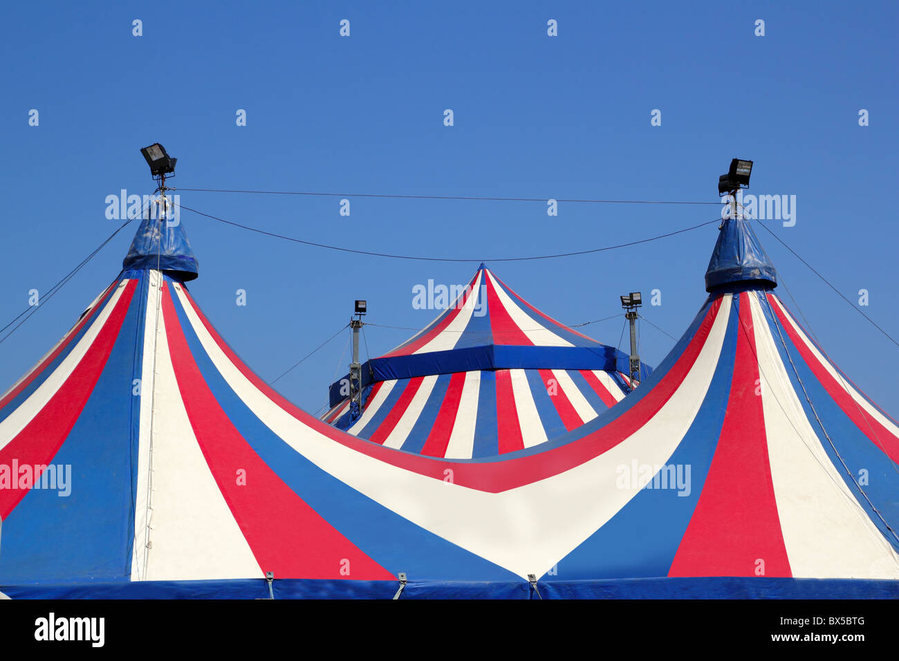 Circus tent under blue sky colorful stripes red white & Circus tent under blue sky colorful stripes red white Stock Photo ...