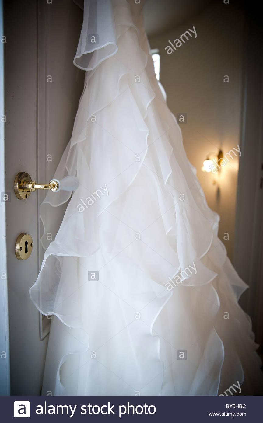 Bridal Wedding Dress Hanging From A Door