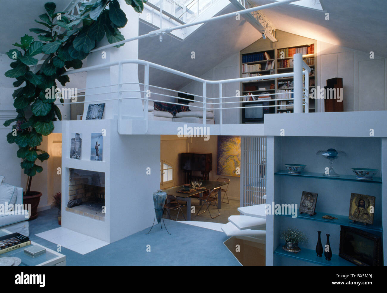 Large green houseplant in white open plan loft conversion with stock photo royalty free image - Open mezzanine ...